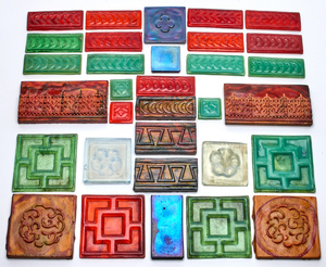 Louis Comfort Tiffany assorted tiles, thirty two